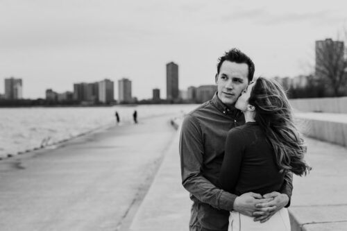 Winter engagement session at Montrose Harbor with Chicago skyline