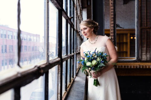Bride waits for groom in bridal suite at Salvage One wedding venue in Chicago