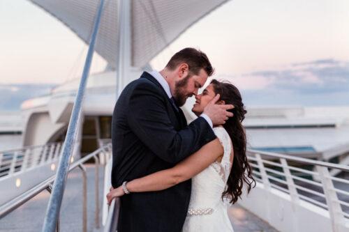 Romantic photo of bride and groom on Calatrava bridge at their Milwaukee Art Museum wedding