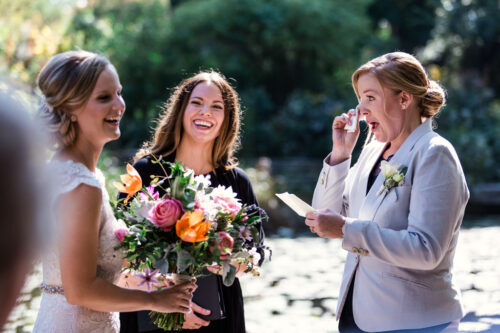 Brides tear up during emotional Alfred Caldwell Lily Pool wedding ceremony in Lincoln Park, Chicago
