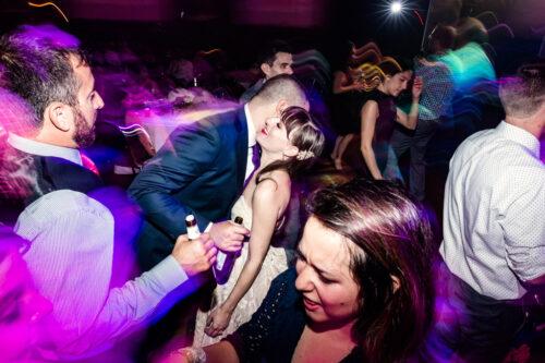 Creative photo of bride and groom on dance floor at their Logan Auditorium wedding reception
