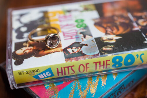 unique Chicago wedding photo of engagement ring on cassette tapes at Headquarters Beercade engagement session