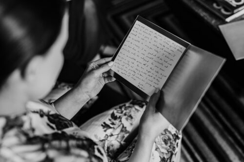 Bride reads love letter from groom at hotel before Ivy Room Chicago wedding