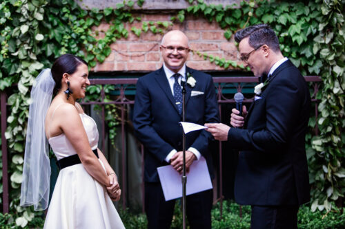 Groom recites vows during Ivy Room Chicago wedding ceremony in courtyard