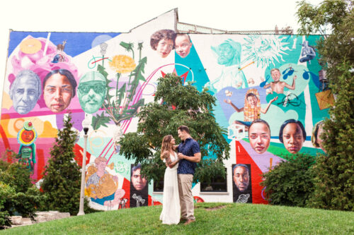 Couple dance in front of colorful Wicker Park mural during their Bucktown engagement session