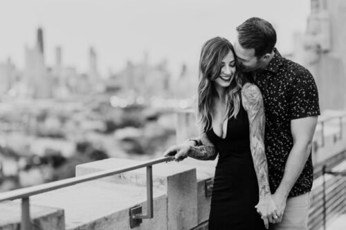 Romantic summer Chicago engagement photo of couple on rooftop of The Robey in Wicker Park