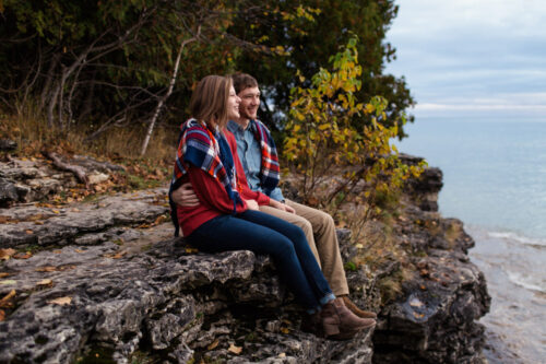 October sunrise Cave Point engagement session in Door County, Wisconsin