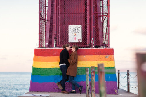 Hollywood Beach engagement photo with rainbow mural