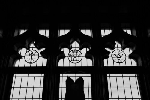 University Club of Chicago wedding dress silhouette hung in library window