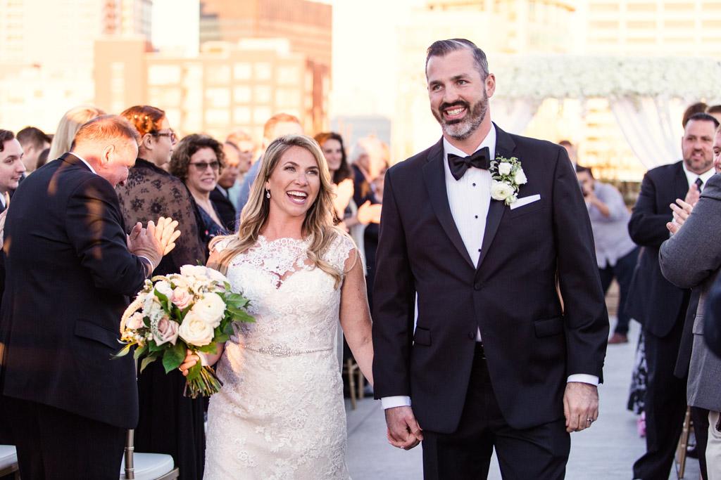Just married bride and groom exit their Evanston Halim Museum wedding ceremony