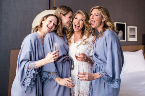 Bride and bridesmaids toast champagne at Chicago Kimpton Gray hotel