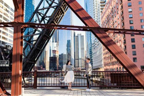 Fun urban Chicago engagement photo with Kinzie bridge and skyline
