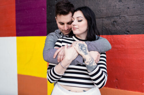 Colorful urban Chicago engagement session with West Loop mural