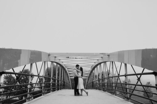 Artistic Lincoln Park engagement photo with bridge on foggy evening