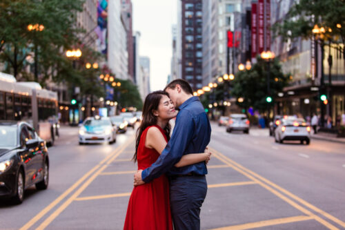 Downtown Chicago engagement photo on State Street with city lights
