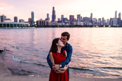 Romantic Chicago engagement session with skyline and sunset at Adler Planetarium