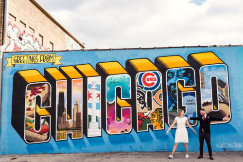 Just married bride and groom with the Greetings From Chicago mural moments after their courthouse elopement