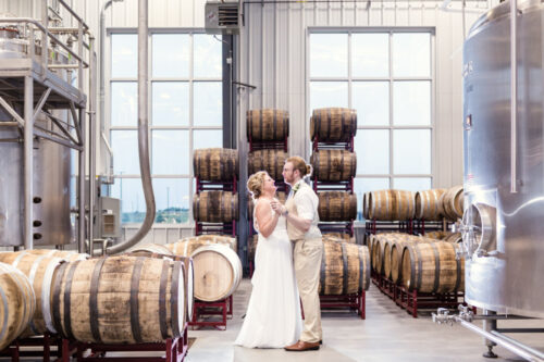Chicago bride and groom dancing at their summer Destihl Brewing wedding in Normal, Illinois
