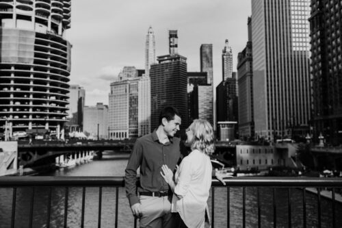 Candid Chicago engagement photo on downtown bridge