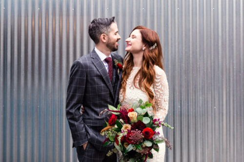 Happy bride and groom at their fall The Joinery Chicago wedding