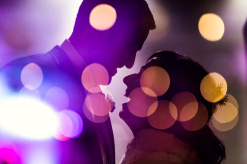 Creative double exposure photo of bride and groom with twinkle lights at Chicago Floating World Gallery wedding