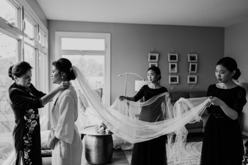 Bride getting ready in Batavia, Illinois home with mother and bridesmaids for December wedding