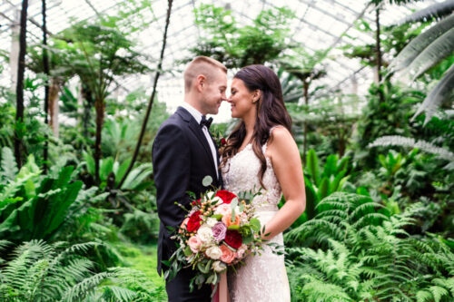 Romantic Garfield Park Conservatory wedding with lush ferns and greenery in Chicago