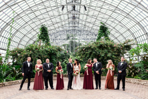 Candid photo of stylish Chicago wedding party at Garfield Park Conservatory