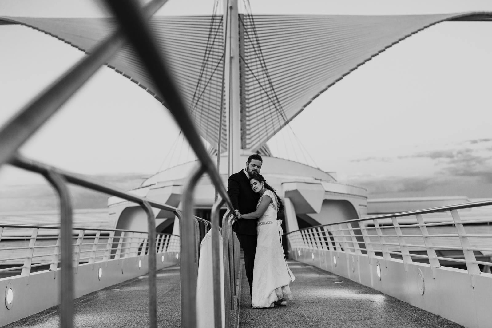 Bride and groom on Calatrava bridge at Milwaukee Art Museum by documentary wedding photographer Emma Mullins Photography
