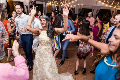 Bride dancing with guests at summer National Museum of Puerto Rican Art and Culture wedding