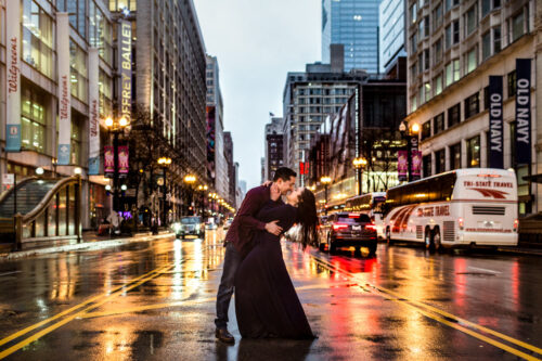 Romantic Chicago winter engagement session downtown in snow and rain