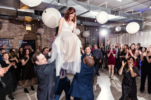 Happy bride in chair at Chicago Jewish wedding at Floating World Gallery