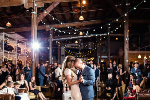 Bride and groom's romantic first dance at Warehouse 109 wedding venue in Plainfield, Illinois