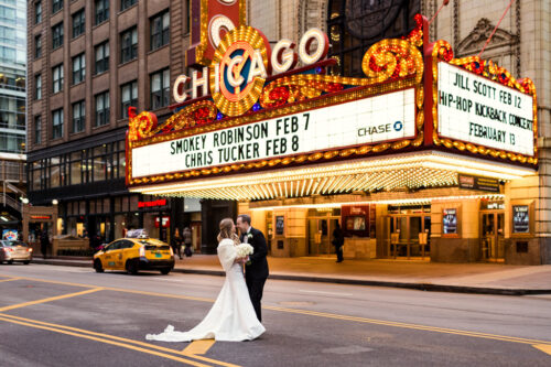 Bride and groom in front of CHICAGO Theatre on State Street at their Renaissance Chicago Downtown wedding