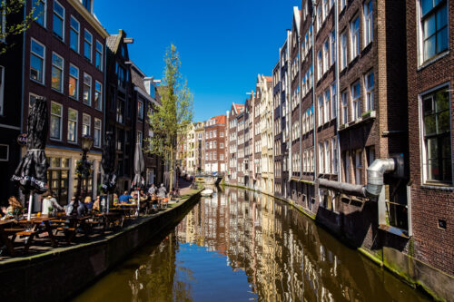 View of Amsterdam canal on springtime afternoon