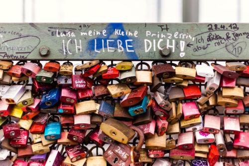Hohenzollern Bridge graffiti and colorful lovers locks