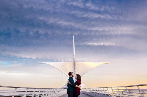 Milwaukee Art Museum engagement photo with Calatrava wings at sunset