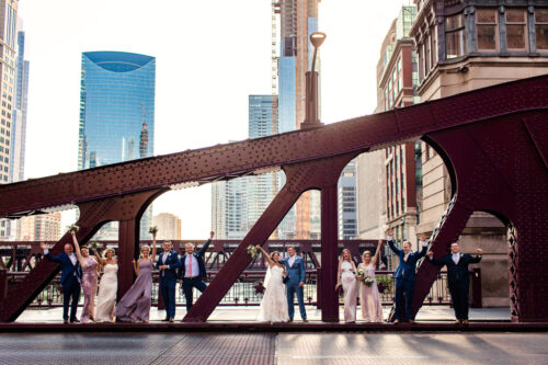 Fun River Roast Chicago wedding party photo on LaSalle Bridge
