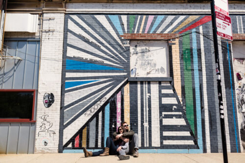 Urban West Loop engagement session with colorful mural on sunny afternoon