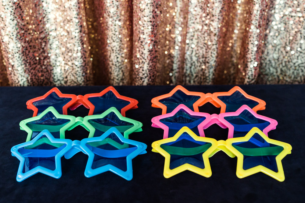 Chicago photo booth prop photo of oversized star shaped sunglasses in various colors by Emma Mullins Photography