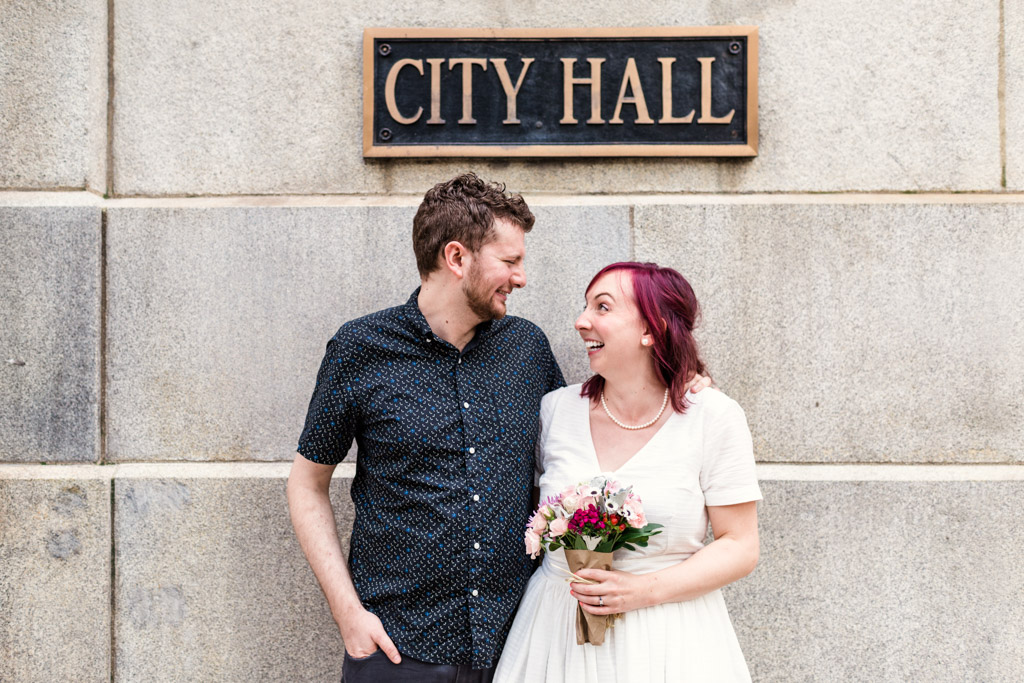Candid Chicago City Hall elopement photo of bride and groom during summer 2020