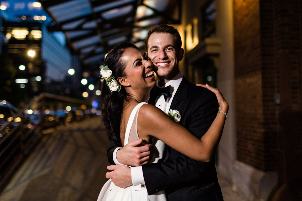 Night photo of happy Chicago newlyweds at their Loft Lucia Microwedding