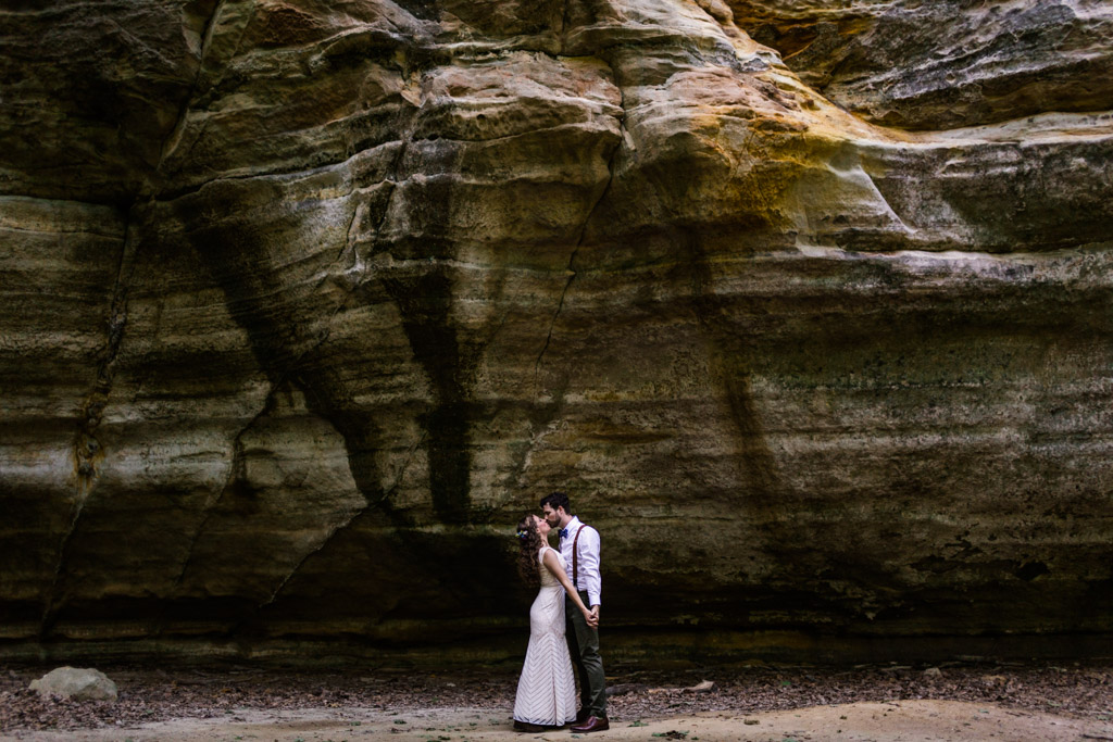 Bride and groom kiss at Illinois Canyon during after their intimate Starved Rock Lodge wedding