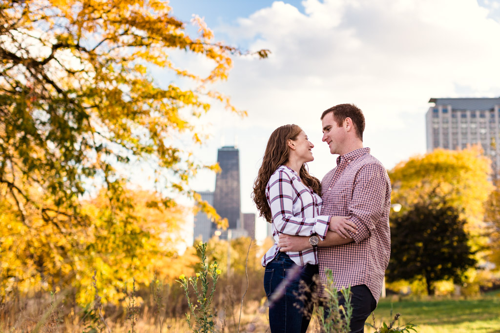 Fall Chicago engagement photo with colorful tree and skyline at Lincoln Park