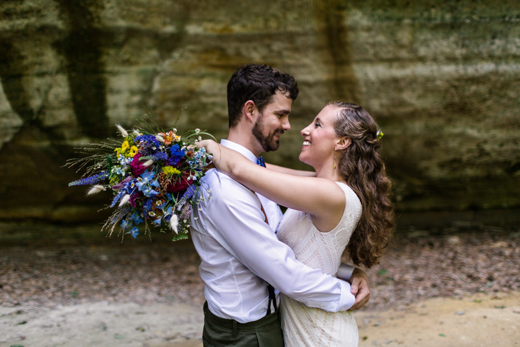 Happy bride and groom at their Starved Rock State Park wedding in Illinois Canyon