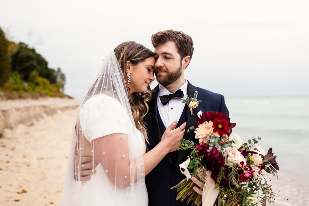 Romantic photo of bride and groom at their destination Michigan wedding in Union Pier