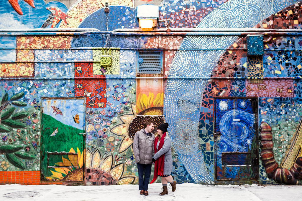 Winter Chicago neighborhood engagement photo of couple in Rogers Park with colorful mural
