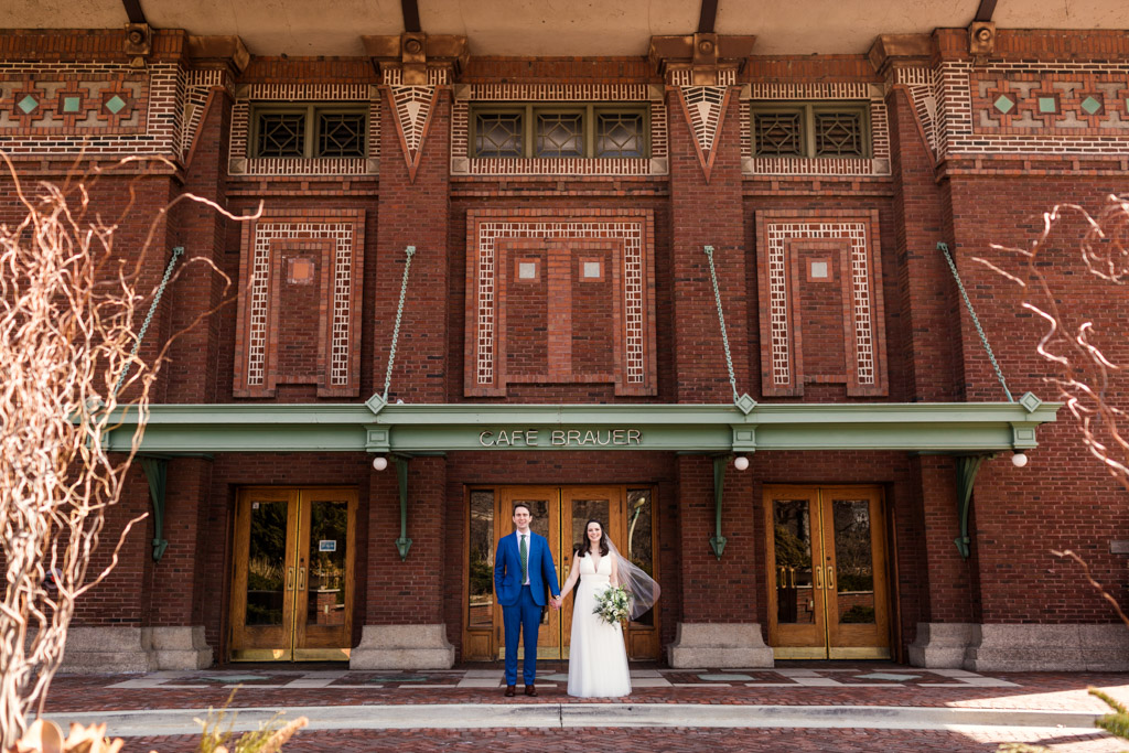 Cafe Brauer wedding photo of bride and groom holding hands outside venue in Lincoln Park
