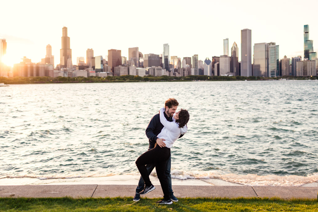 Romantic South Loop engagement photo of couple kissing with Chicago skyline