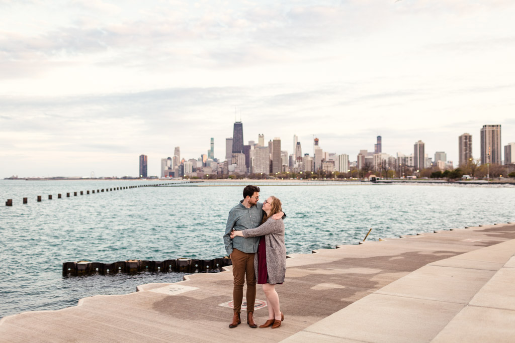 Chicago spring engagement photo at lakefront with skyline view